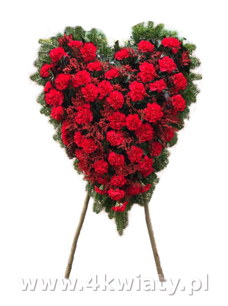 Wieniec serce z goździków. Wieniec czerwone kwiaty.
