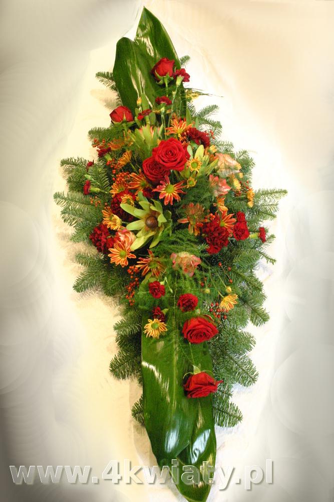 Wiązanka na pogrzeb podłużna, czerwone kwiaty: róże, goździki, leukadendron.
